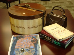Books, Neiman Marcus Hat Box and other items from the Enid Klass collection at the DJHS